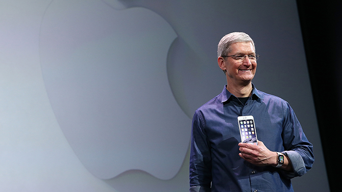 CUPERTINO, CA - SEPTEMBER 09: Apple CEO Tim Cook shows off the new iPhone 6 and the Apple Watch during an Apple special event at the Flint Center for the Performing Arts on September 9, 2014 in Cupertino, California. Apple is expected to unveil the new iPhone 6 and wearble tech. (Photo by Justin Sullivan/Getty Images)